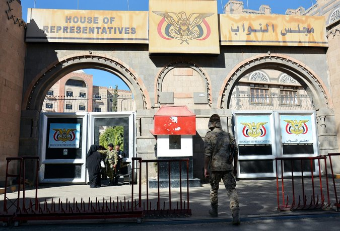 Houthi rebels standing guard outside the headquarters of Yemen's Parliament in Sana on Sunday Photo Credit: Wadia Mohammed/European Pressphoto Agency