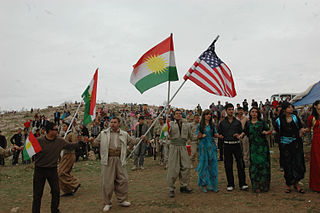81416_Local_citizens_wave_Kurdish_and_American_flags_during_the_Kurdish_regional_government_new_year's_celebration_in_Dahuk_in_2008 (1)