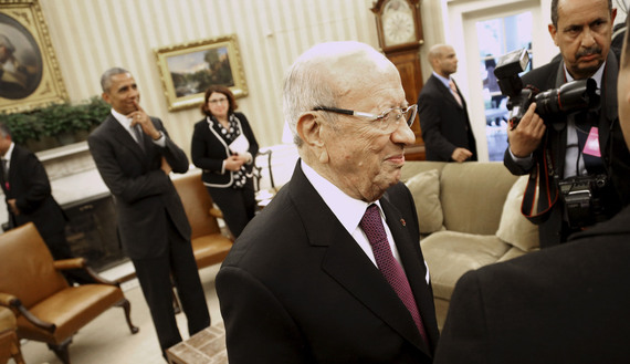 Tunisia's President Essebsi walks toward journalists and members of his staff after talking to reporters following his meeting with U.S. President Obama in the Oval Office at the White House in Washington