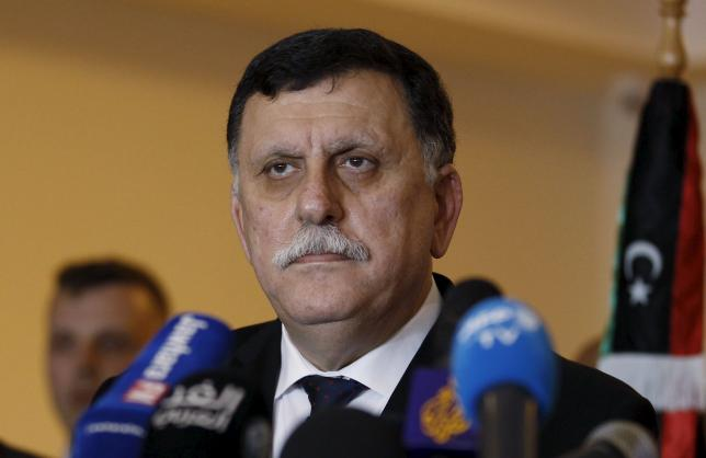 Libyan prime minister-designate under a proposed National Unity government Fayez Seraj attends a joint news conference with European Union foreign policy chief Federica Mogherini in Tunis, Tunisia