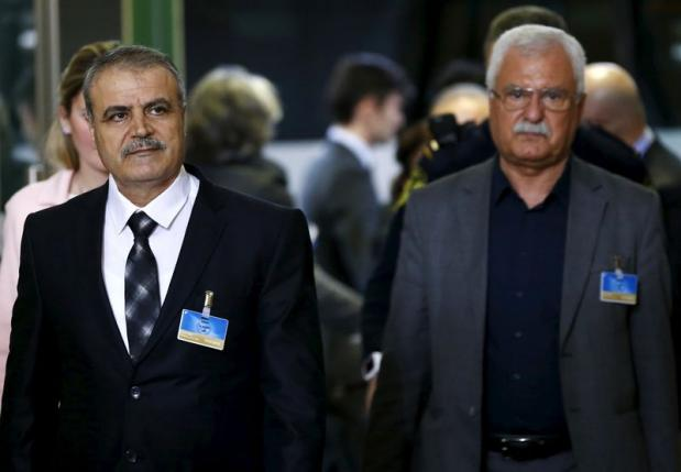 Asaad Al-Zoubi, head of the Syrian opposition delegation, arrives with George Sabra, a member of the High Negotiations Committee, for peace talks at the UN in Geneva, Switzerland