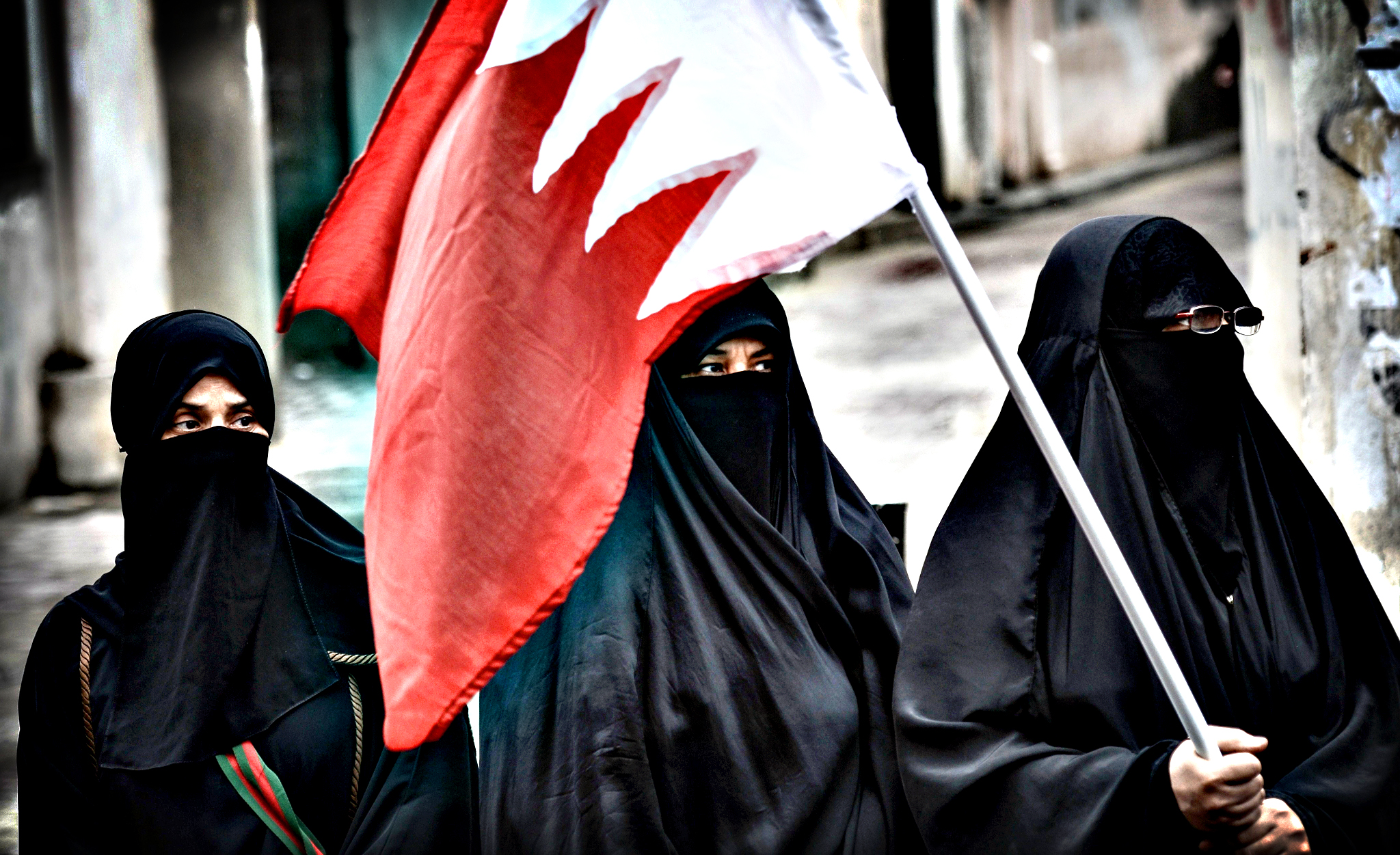 A Bahraini woman holds her national flag...A Bahraini woman hold